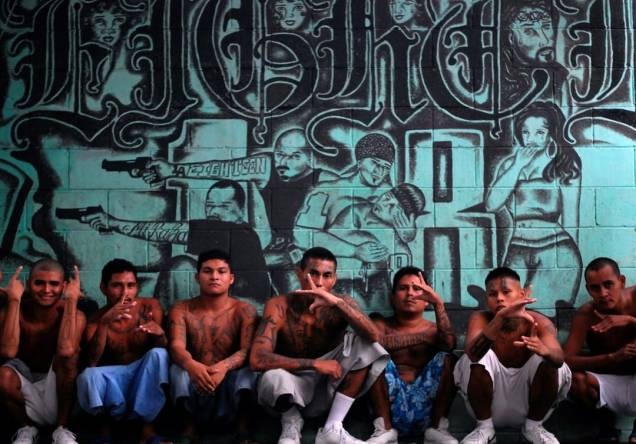 Gang members who are also inmates pose for a photograph at a prison in Quezaltepeque