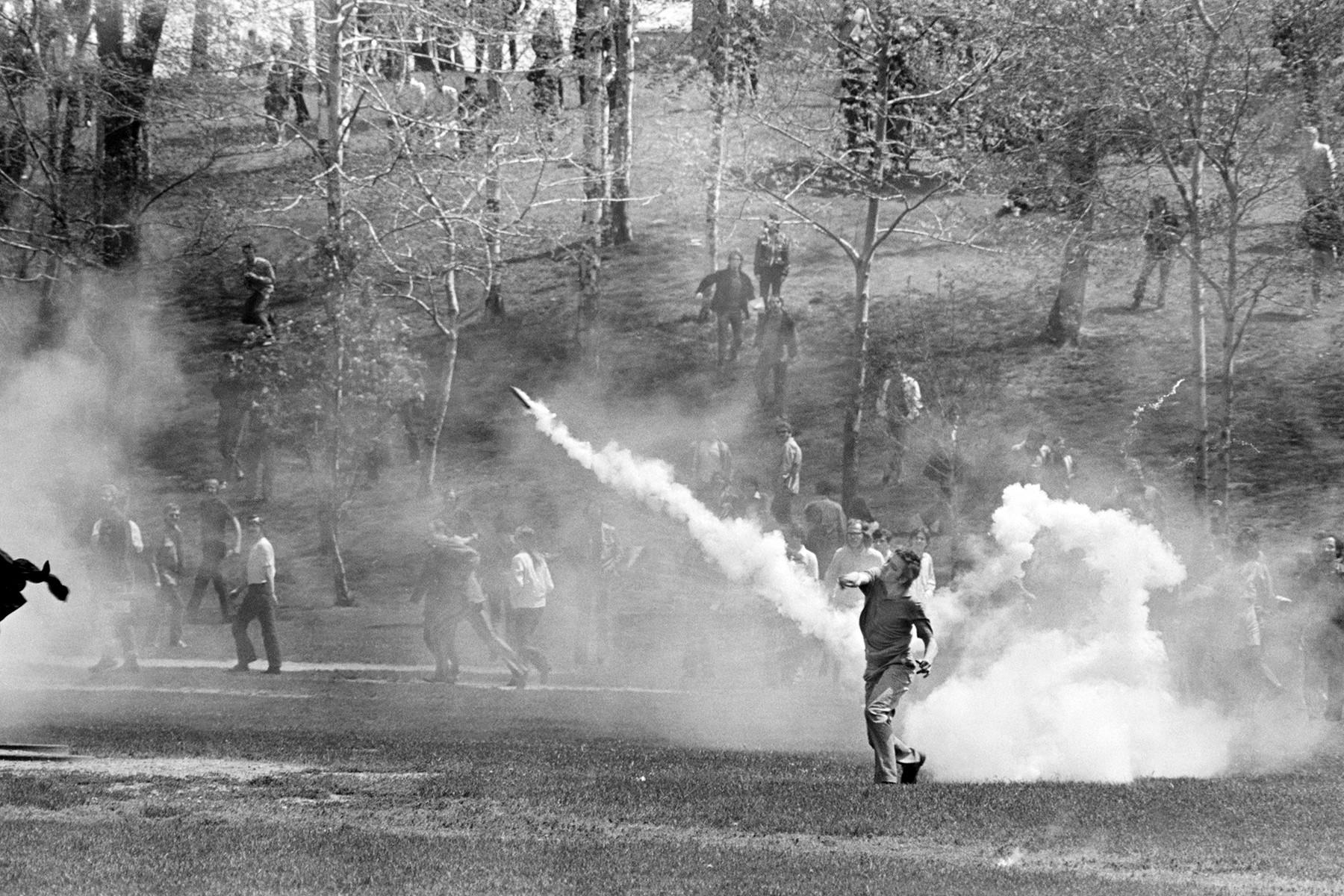 Student Hurls Tear Gas Back